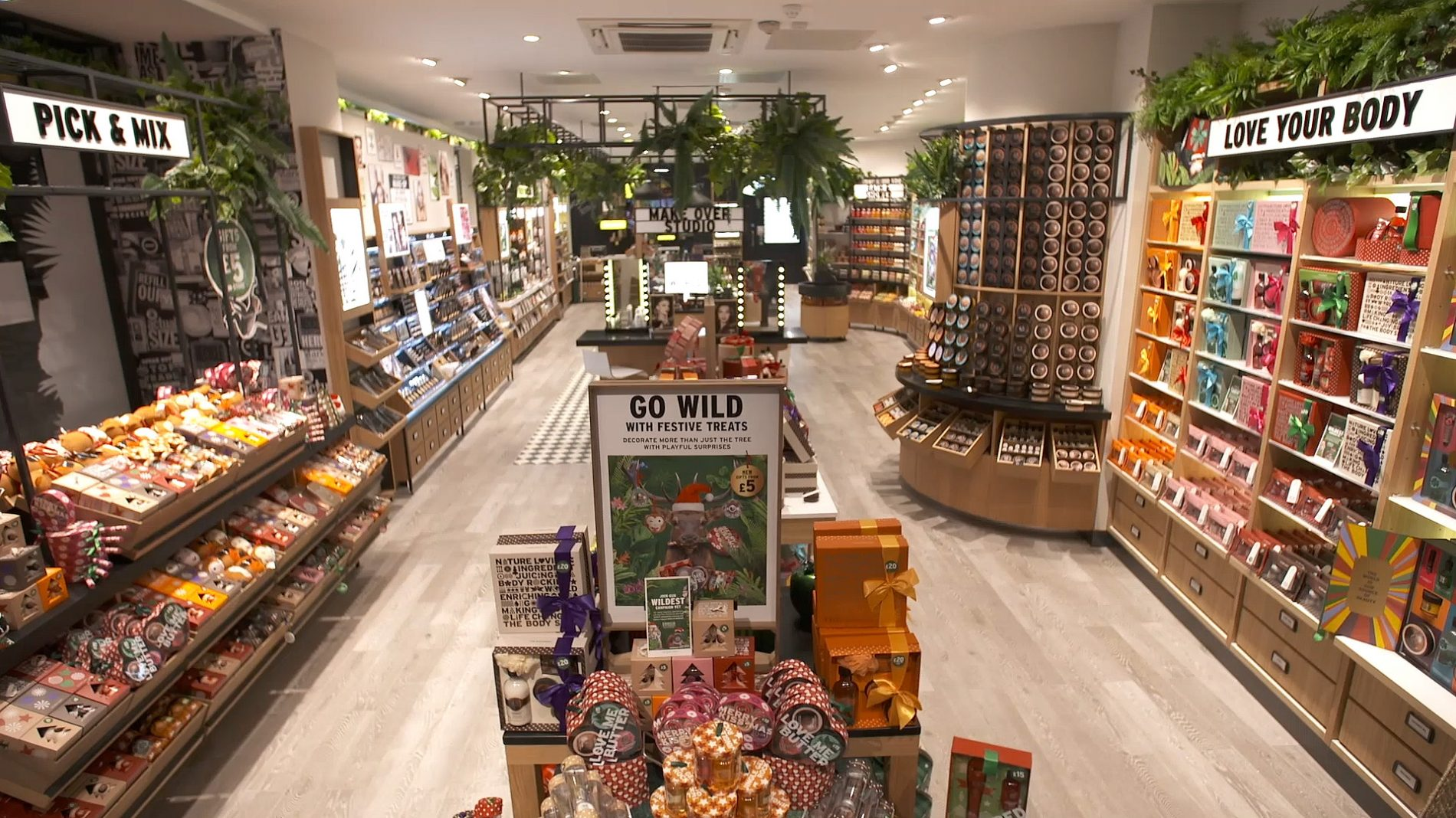 retail design of the body shop store with shelves full of beauty products