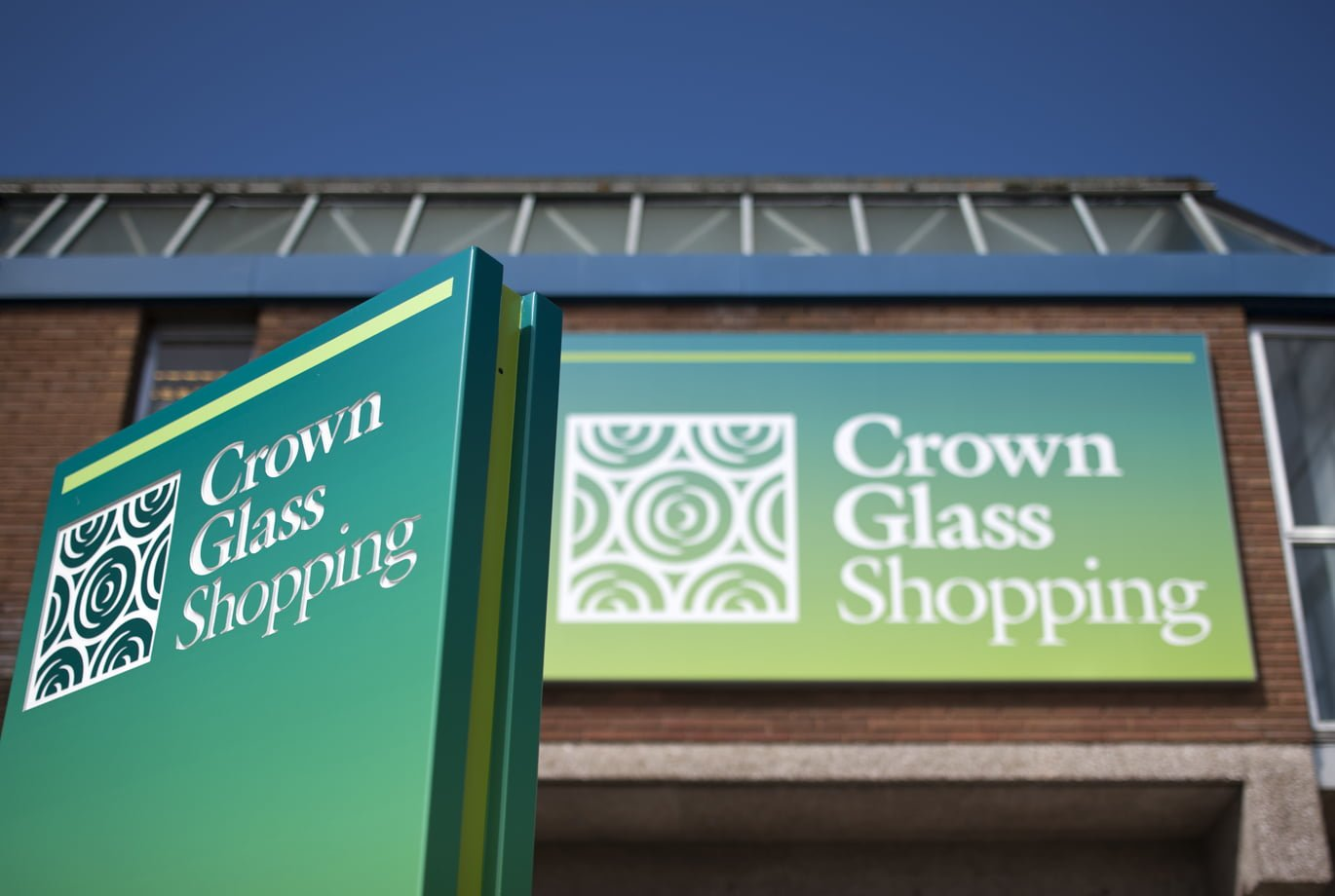 Front entrance signage for crown glass shopping