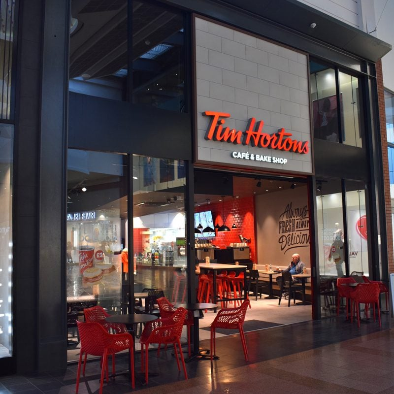 exterior design of tim hortons coffee shop with glass facade
