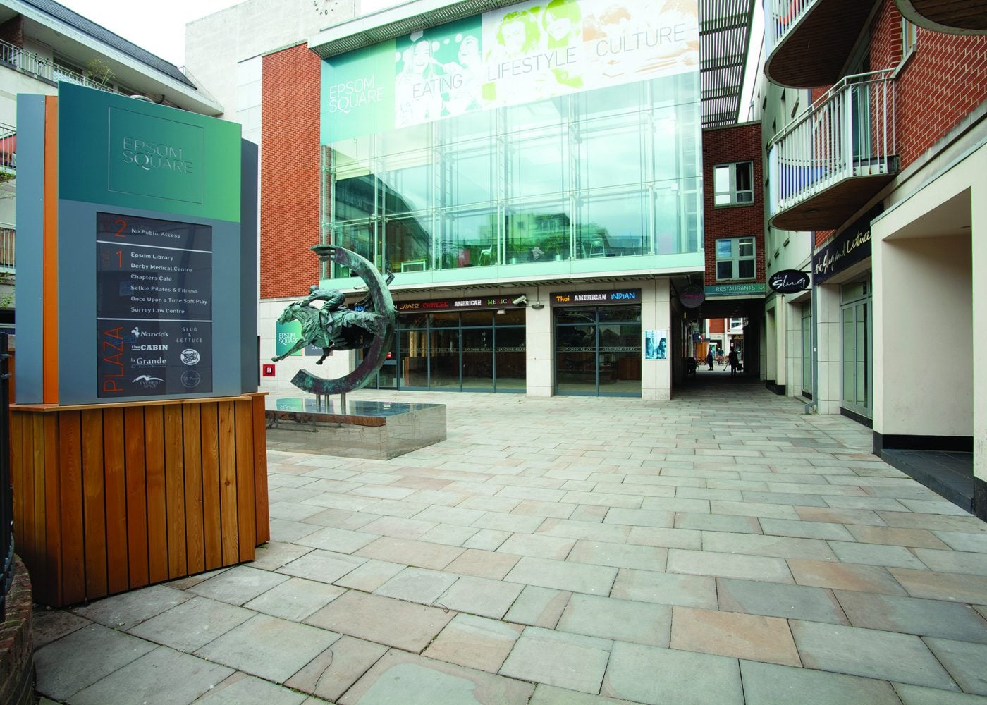Exterior of Epsom Square entrance with horse riding sculpture and signage