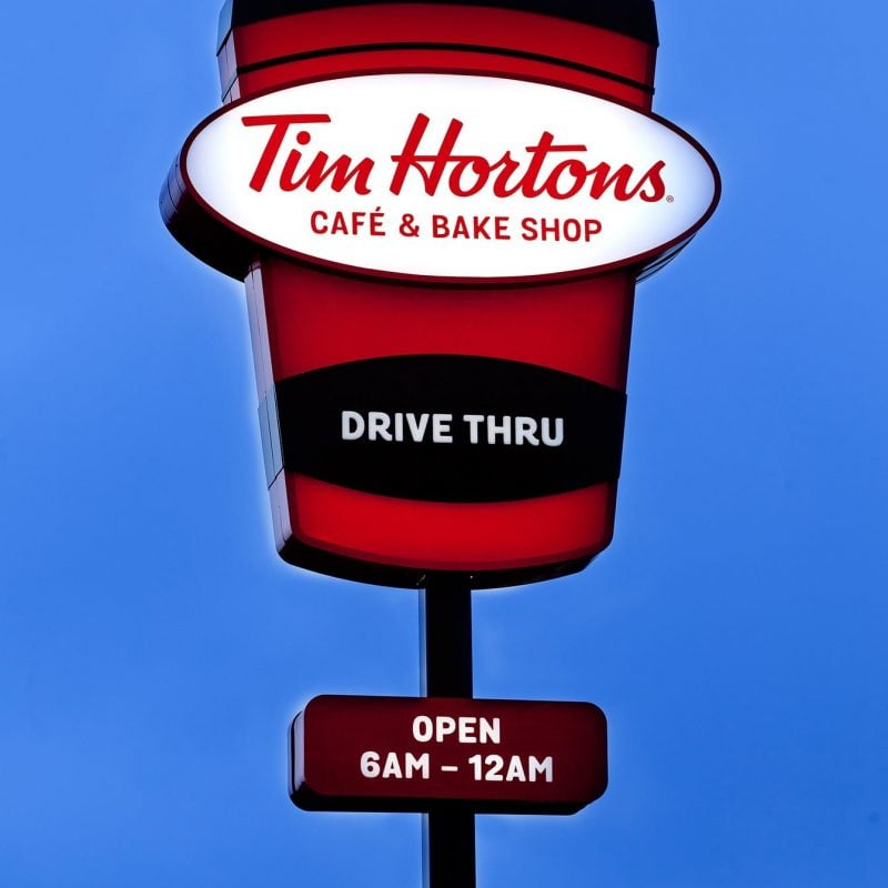 Exterior illuminated Tim Hortons coffee shop signage