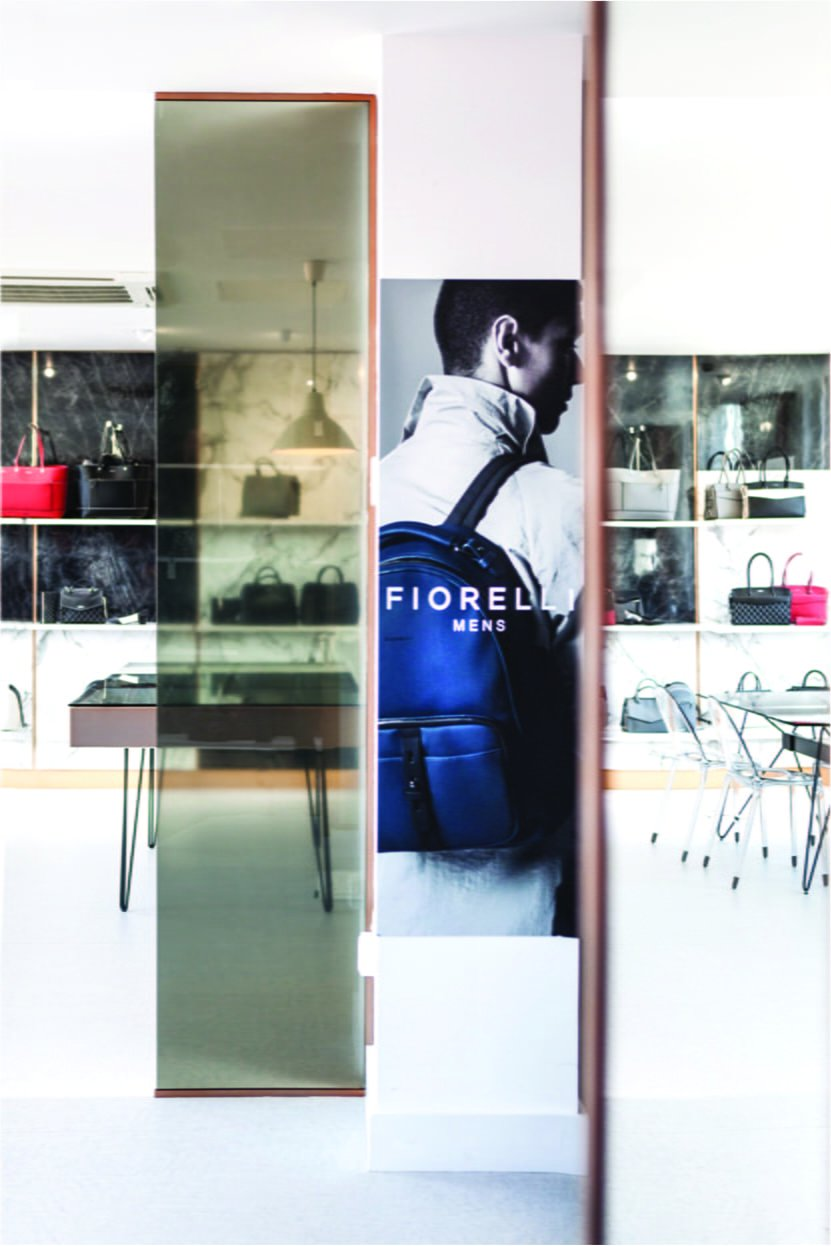 Poster of male model with backpack on the wall in Fiorelli showroom