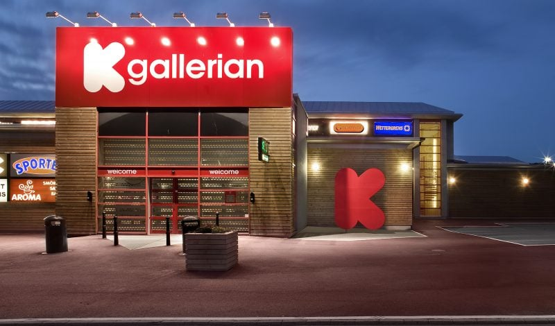 shopping centre front entrance with illuminated red signage for Kallered centre
