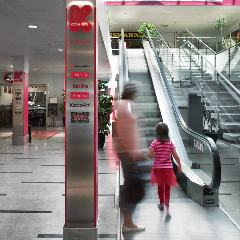 Interior way-finding and escalator inside Kallered shopping park