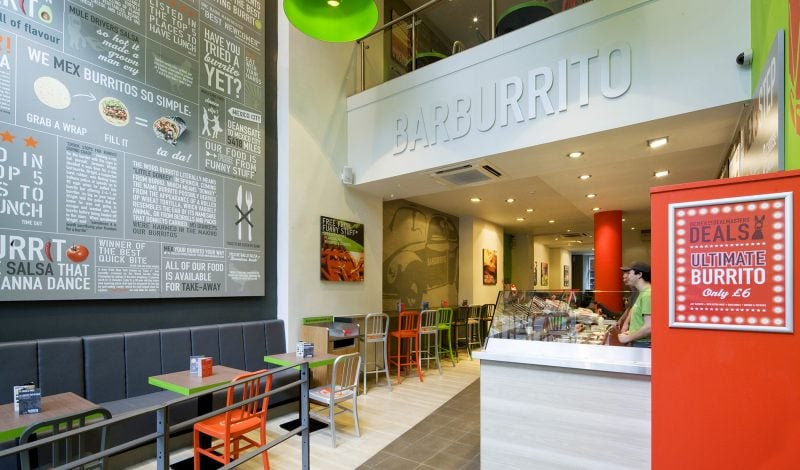 interior design of Barburrito restaurant with wall graphics and colourful furniture