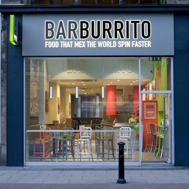 exterior of barburrito restaurant with glass facade