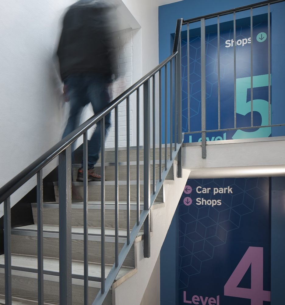 Stairway at Priory shopping centre with way-finding wall graphics