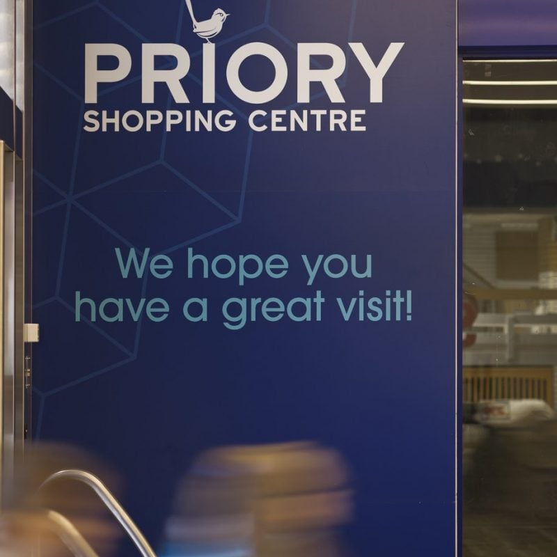 Welcome signage for the priory shopping centre