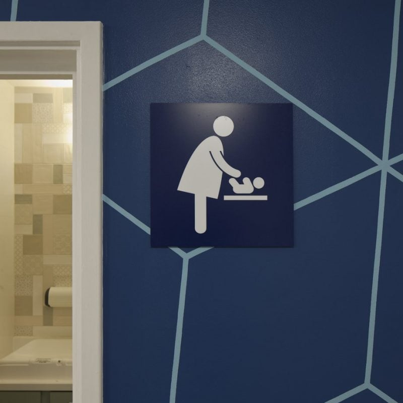 Family room graphic of women changing a baby for the toilets at Priory shopping centre