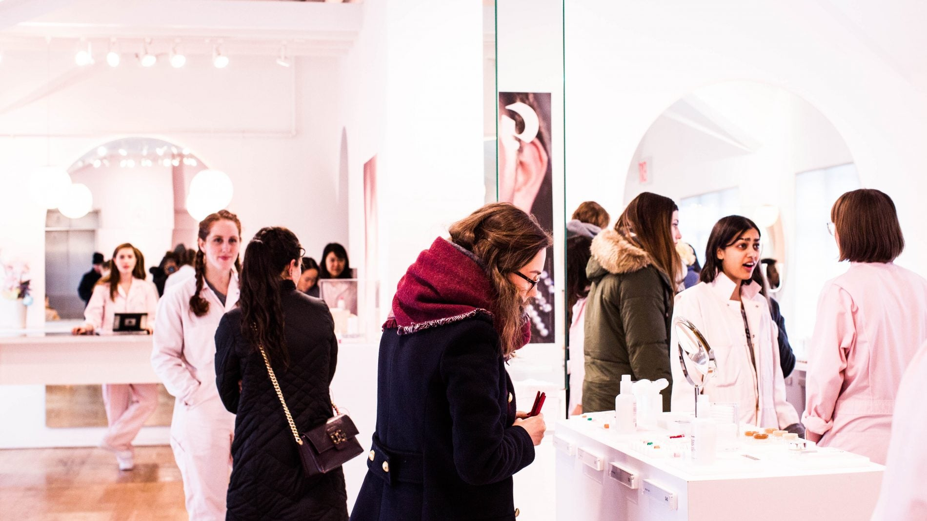 Customers browsing in the digital first Glossier showroom