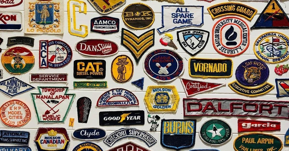 Wall of traditional branded fabric badges
