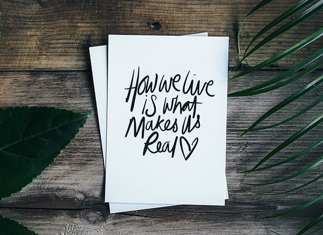 Calligraphy with quote How we live is what makes us real