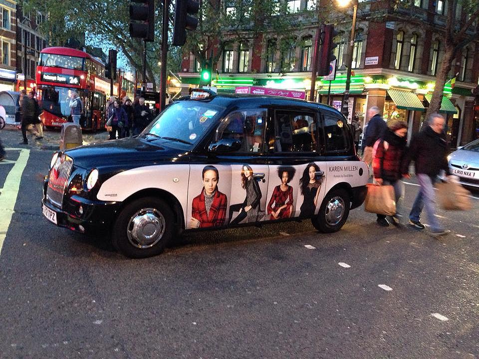 black taxi with karen millen advert