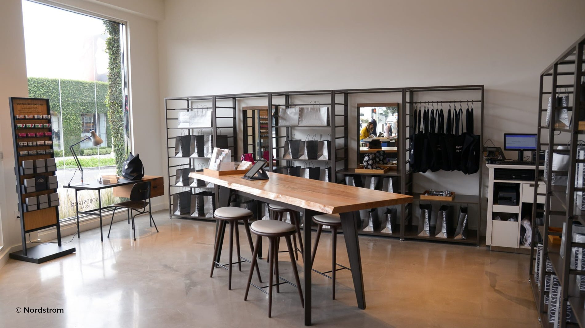 Innovative Nordstrom local concept store with high table