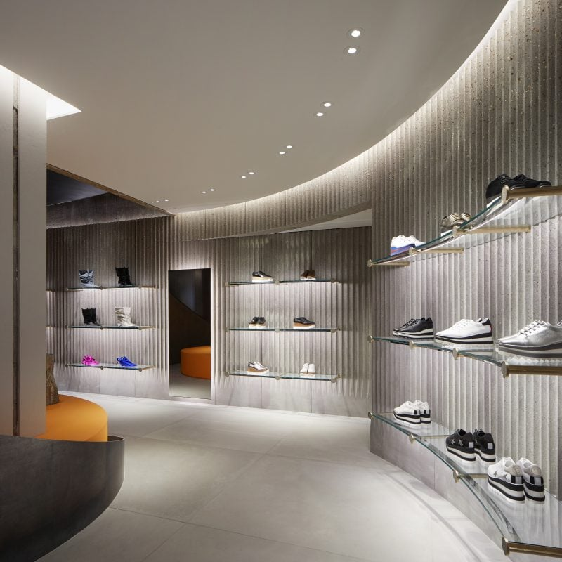 Curved shoe wall in Stella McCartney's new sustainably designed Old Bond Street Store in London