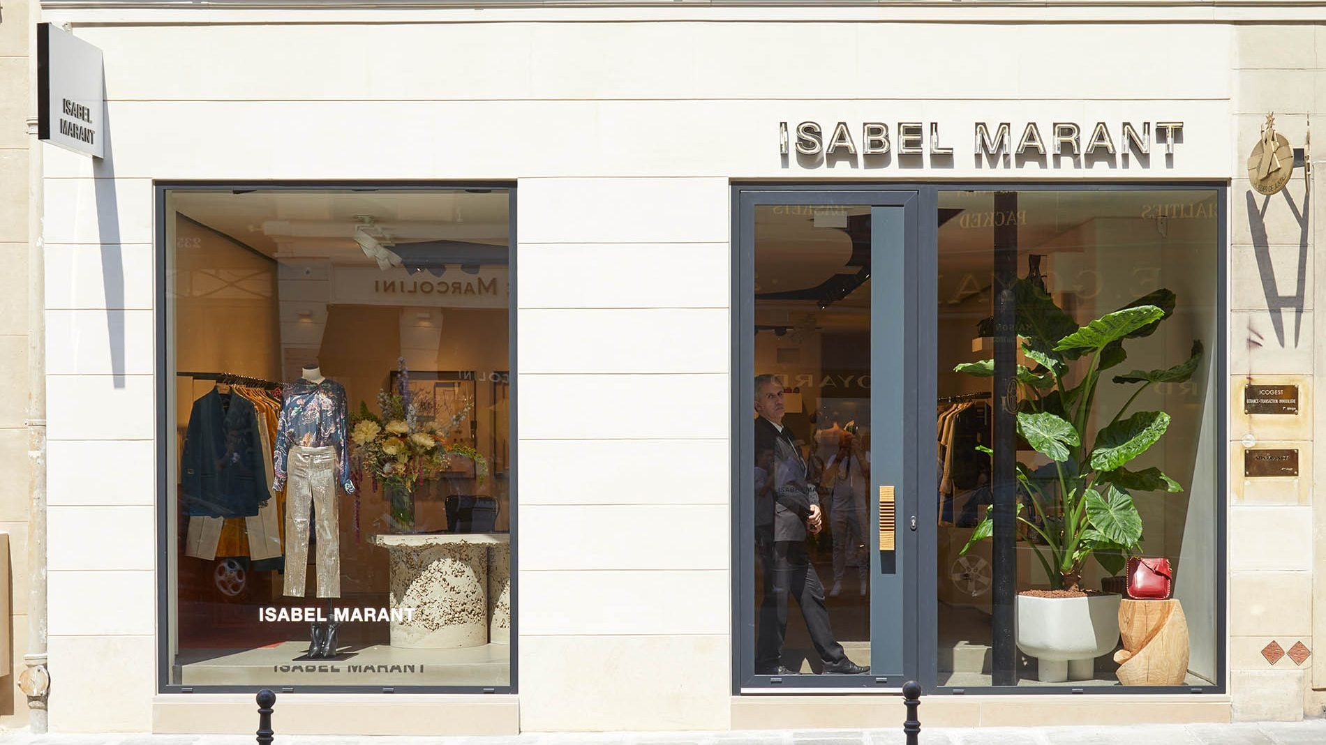 Isabel Marant store front with large plant