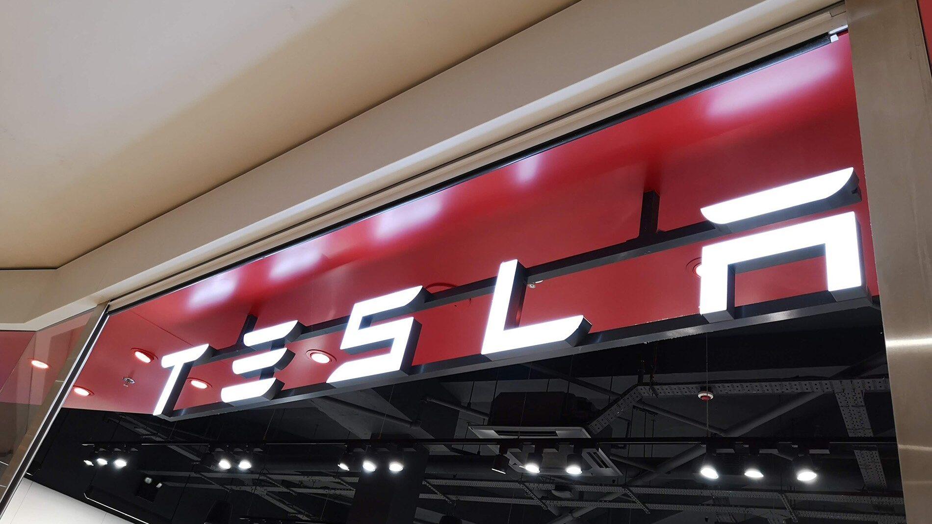 Tesla store front with illuminated logo and neat finishings