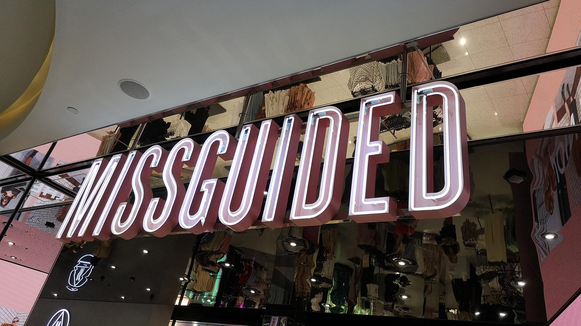 Missguided store front illuminated logo and neat finishings