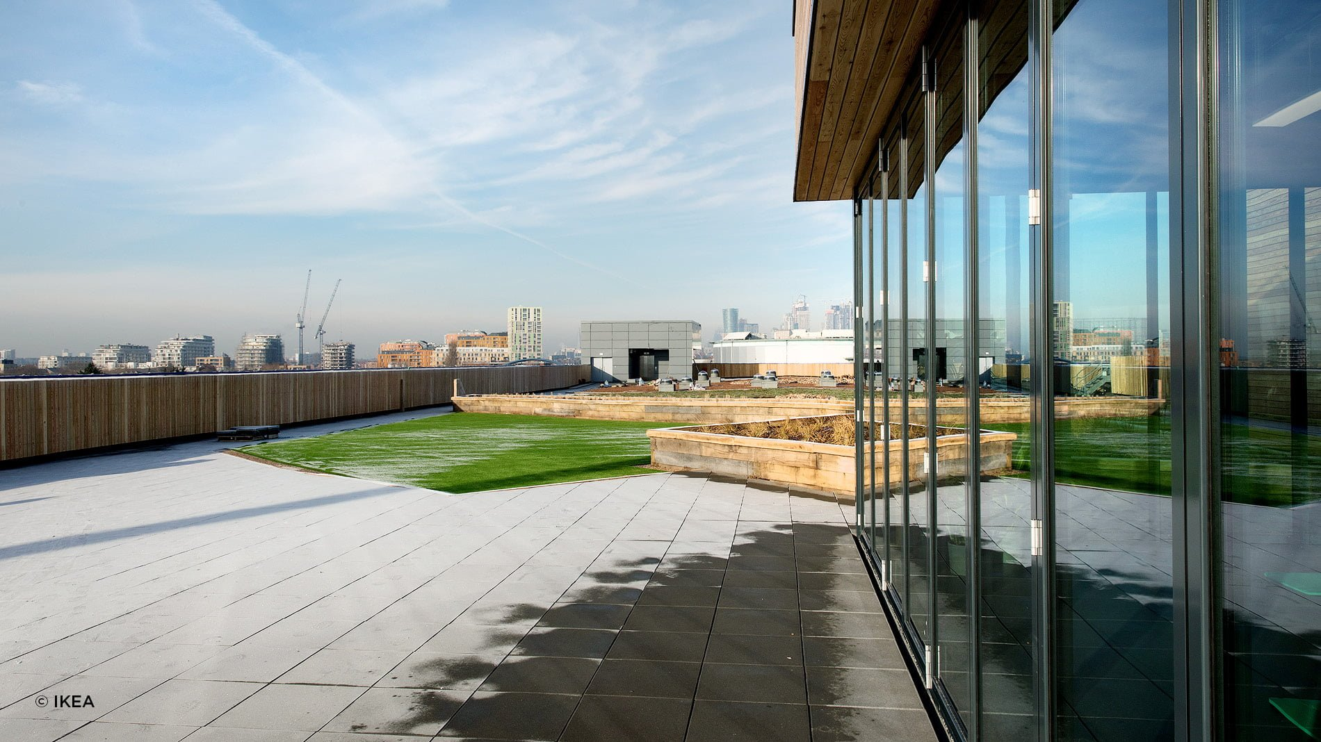 Exterior of IKEA Greenwich and London skyline. IKEA's most sustainable store in the UK